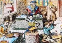 La nascita della moneta - Maestri della zecca al lavoro per coniare monete in una miniatura medievale.
