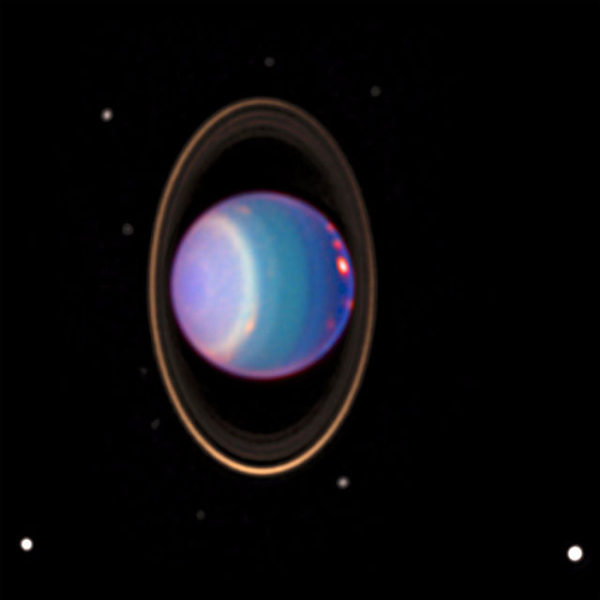 Immagine di Urano e del suo sistema di anelli e di satelliti, ripresi dal Telescopio Spaziale Hubble, nel 1997.